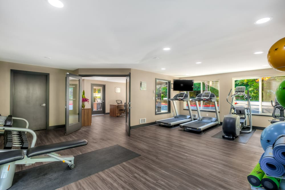 Fitness center with plenty of individual workout stations at Karbon Apartments in Newcastle, Washington