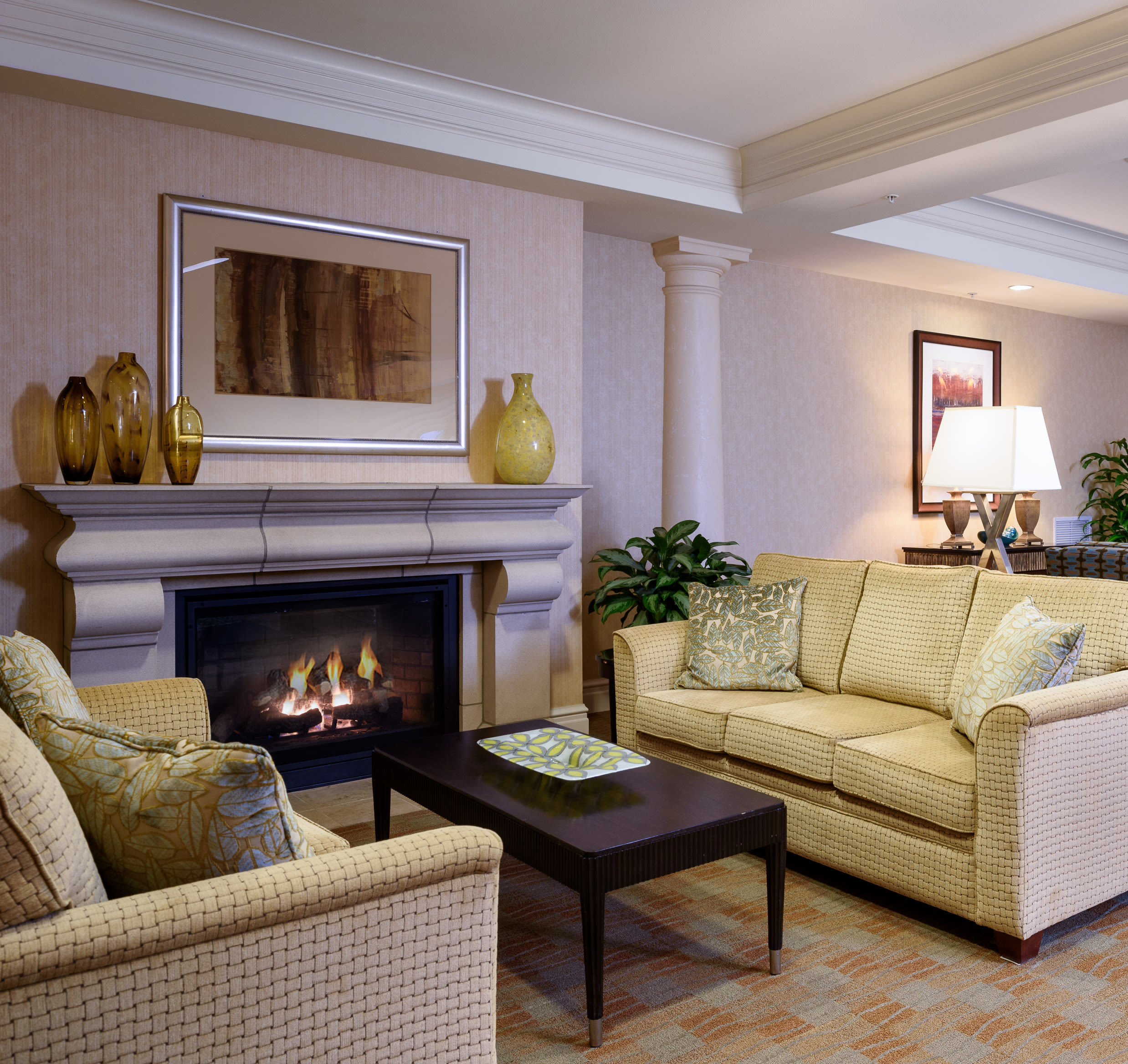 Common fireplace at The Bellettini in Bellevue, Washington