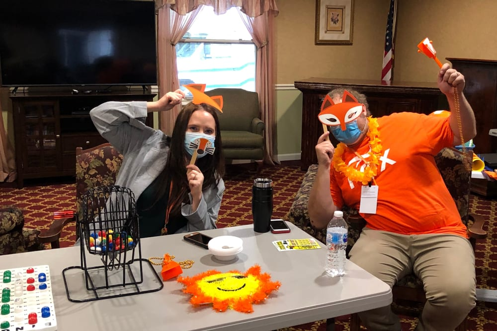 Christina and Mike wearing props at Heritage Hill Senior Community