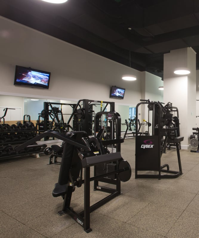 A modern fitness center with plenty of workout stations at The Metropolis in New York, New York