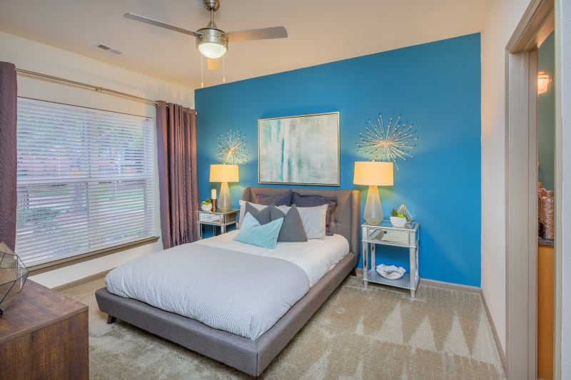 Main bedroom with ceiling fan at Presley Oaks in Charlotte, North Carolina