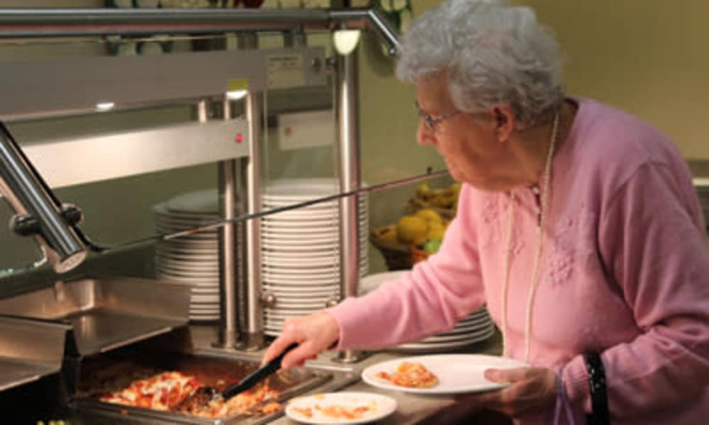 Resident enjoying dining services at Traditions of Hanover in Bethlehem, Pennsylvania