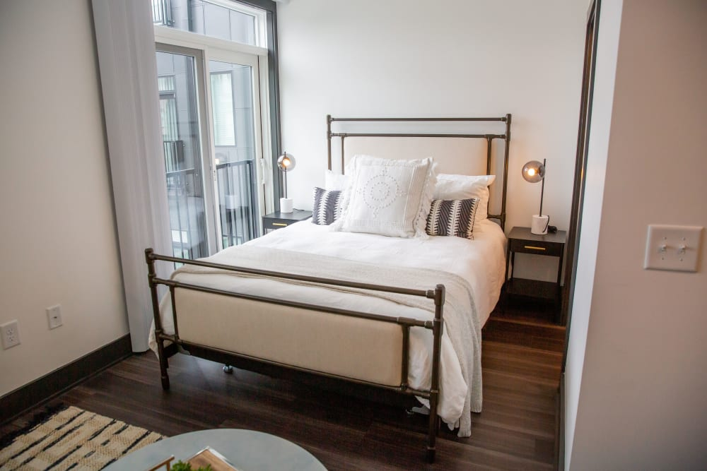 Bed area in a studio apartment at Belcourt Park in Nashville, Tennessee
