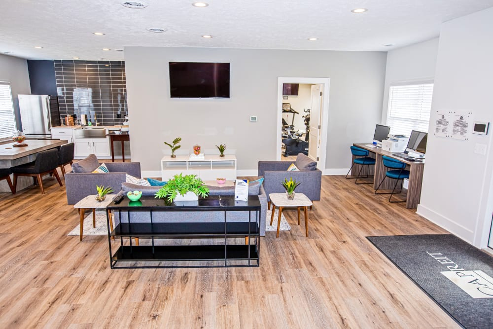 A community  clubhouse with comfortable seating at Silver Lake Hills in Fenton, Michigan