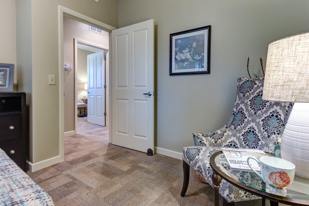 Model bedroom with seating at Maplewood at Orange in Orange, Connecticut
