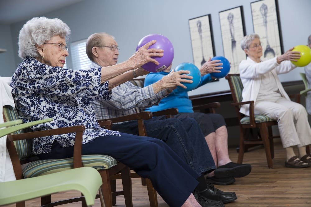 Seniors doing exercises at The Oxford Grand Assisted Living & Memory Care