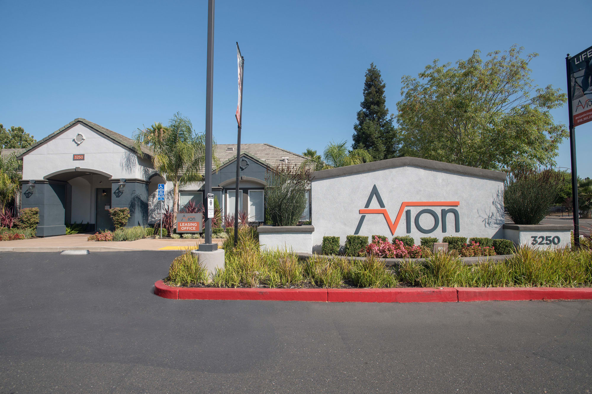 Sign at entry into Avion Apartments in Rancho Cordova, California
