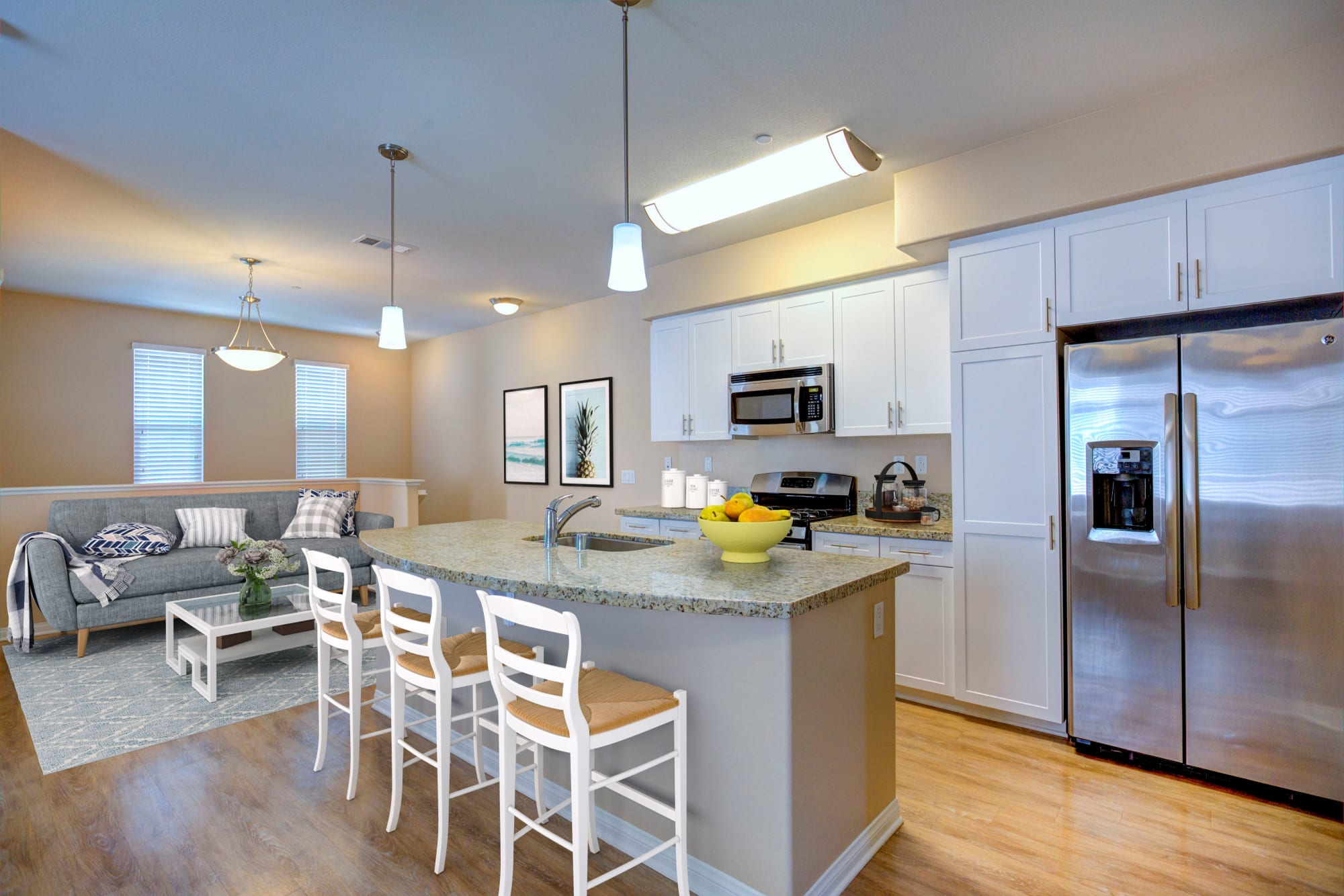 A kitchen, with open floor plan at Palisades Sierra Del Oro in Corona, California