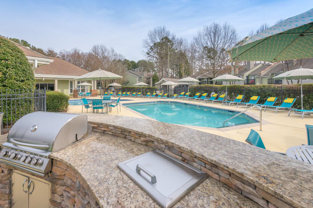 Poolside BBQ with tons of space to cook for all your friends at The Madison in Charlotte, North Carolina