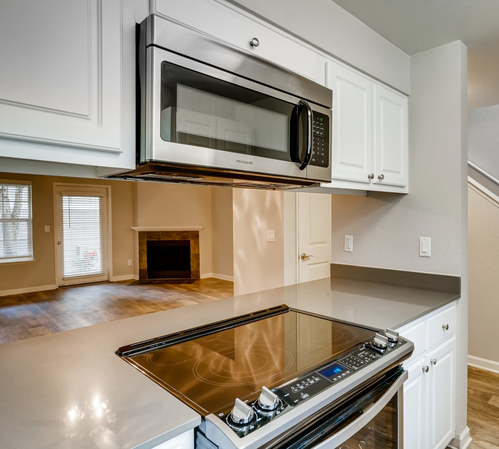 Kitchen with a pass-through window at Slate Ridge at Fisher's Landing Apartment Homes in Vancouver, Washington