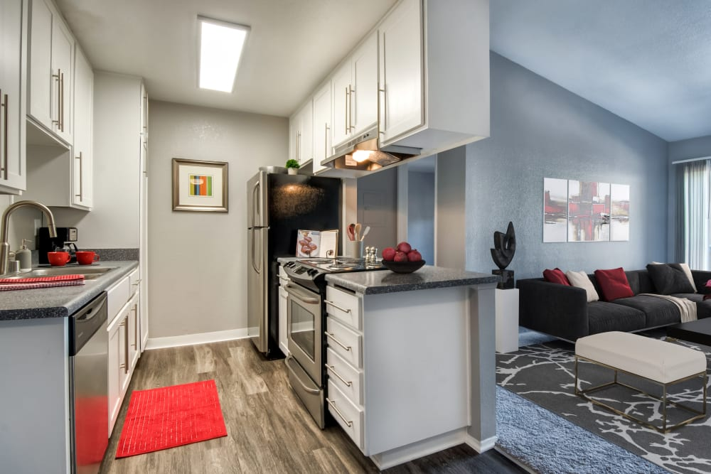 Kitchen with wood-style flooring at Terra Nova Villas in Chula Vista, California