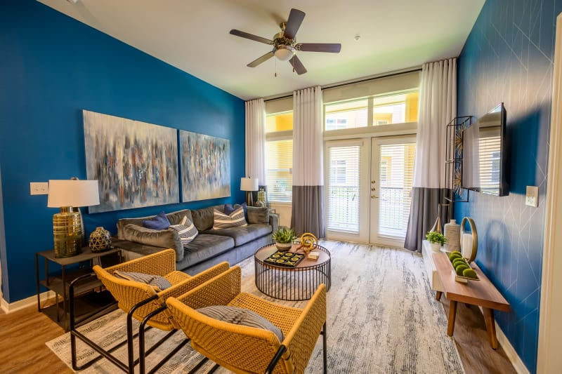 Spacious living room with ceiling fan at Aspire at 610 in Houston, Texas
