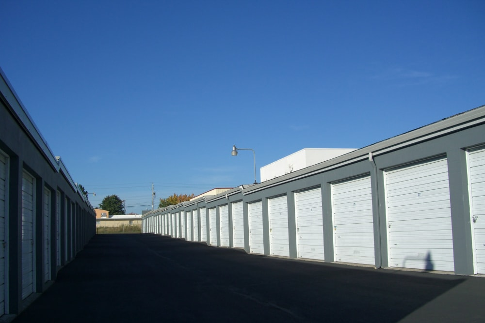 A wide driveway between rows of storage units at U-Lock-It Self Storage in Vancouver, Washington