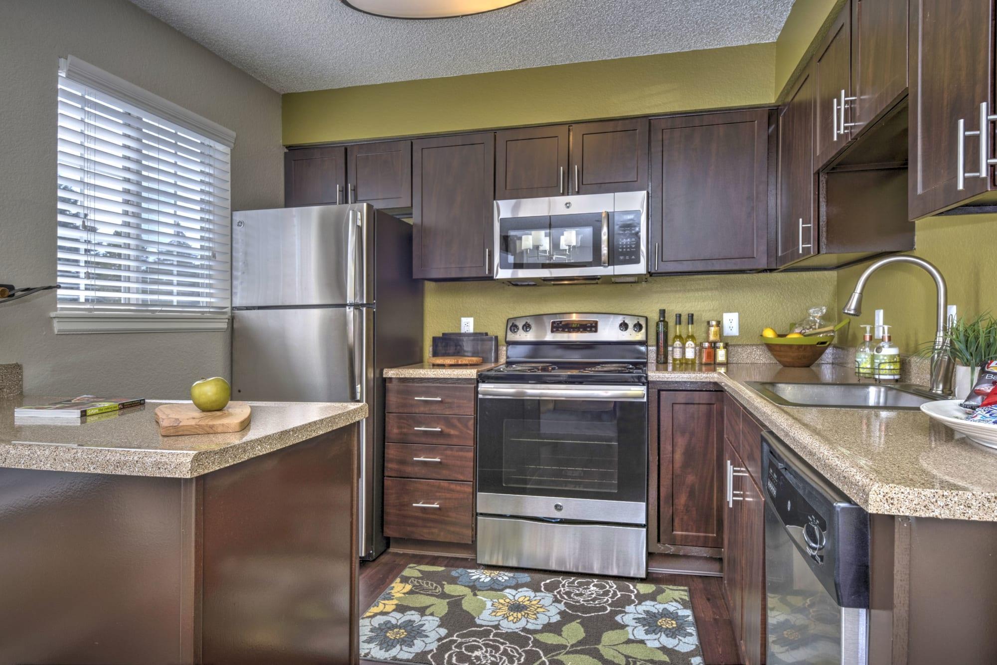 Vibrant espresso cabinetry at Arapahoe Club Apartments in Denver, Colorado