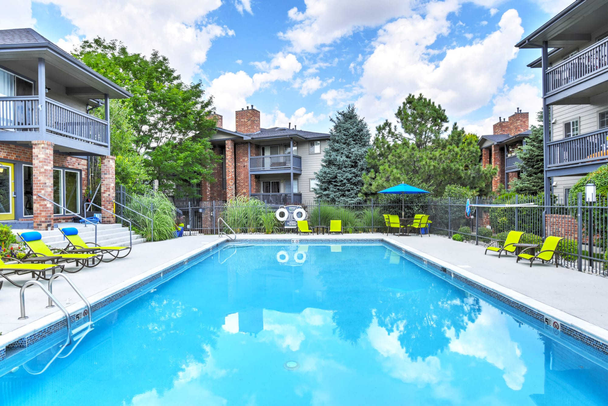 A large sparkling pool at Arapahoe Club Apartments in Denver, Colorado