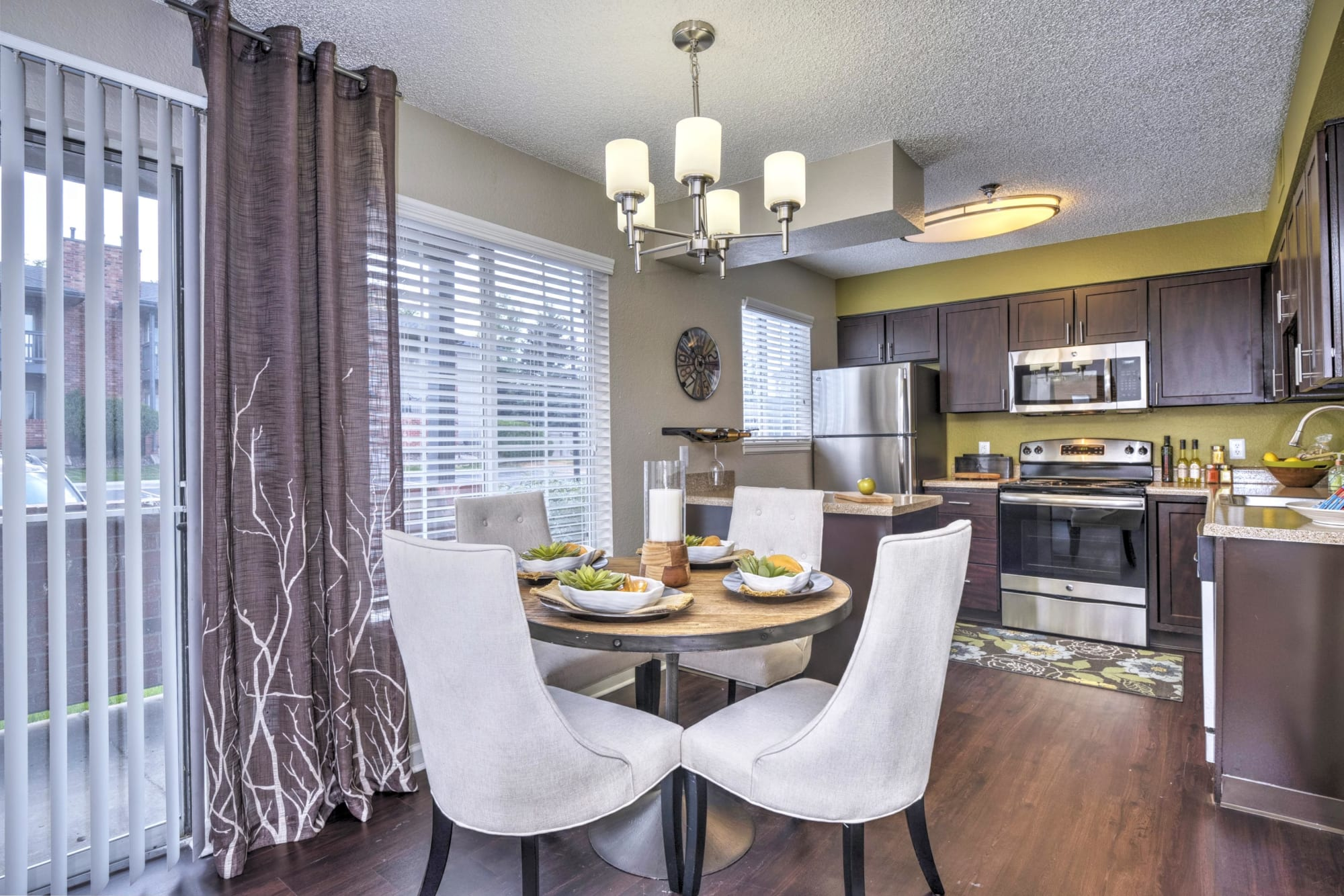 Kitchen overlooking the dining room in an open floor plan at Arapahoe Club Apartments in Denver, Colorado