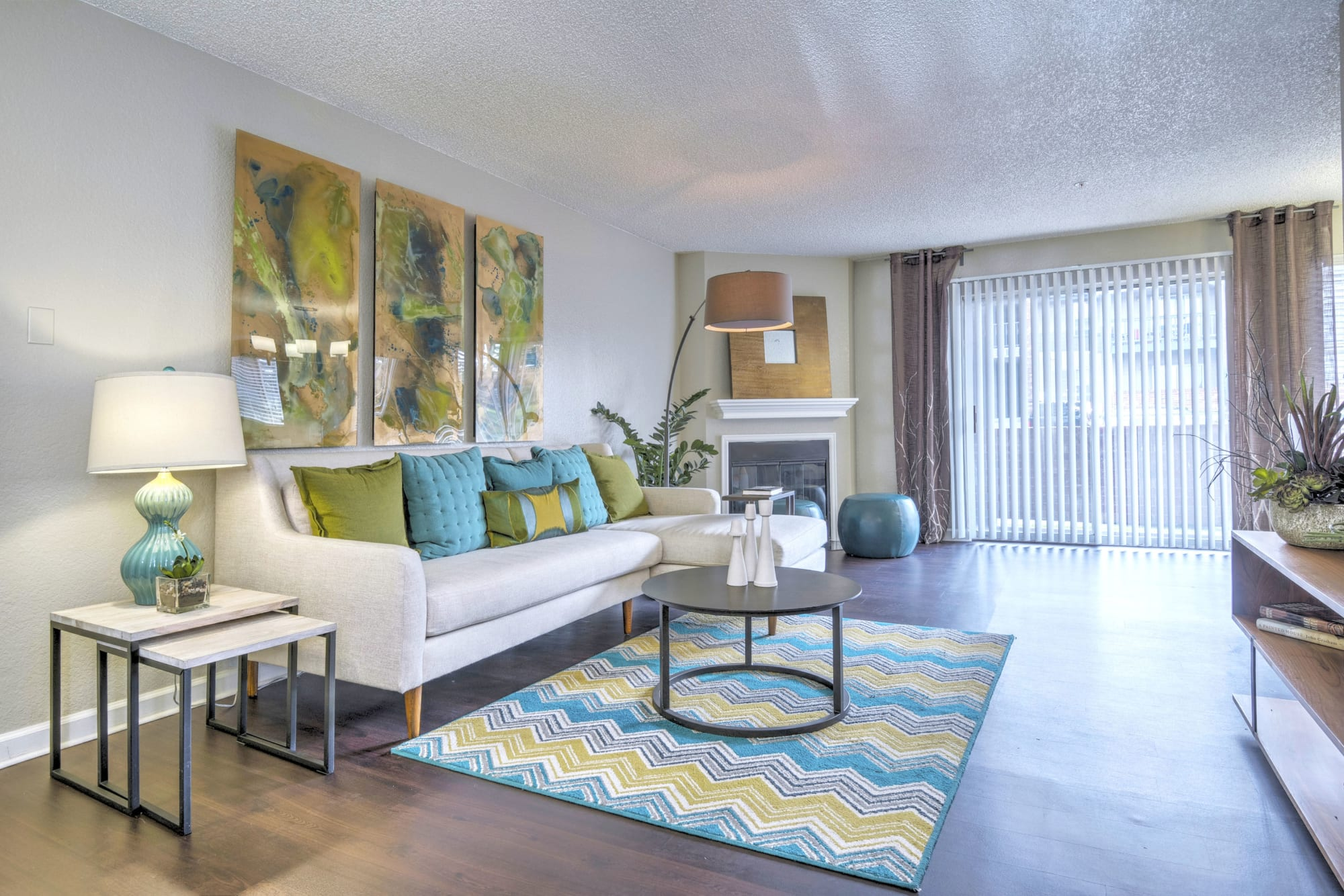 A spacious living room filled with sunlight at Arapahoe Club Apartments in Denver, Colorado