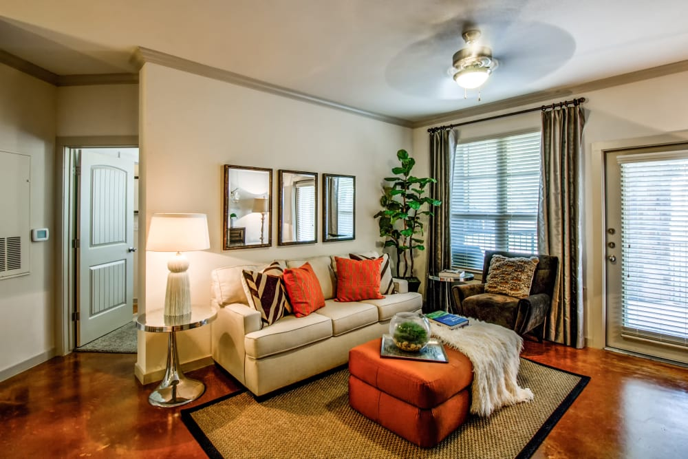 Well lit living room at Firewheel Apartments in San Antonio