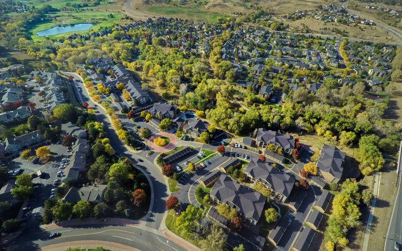 An aerial view of the property at The Crossings at Bear Creek Apartments in Lakewood, Colorado