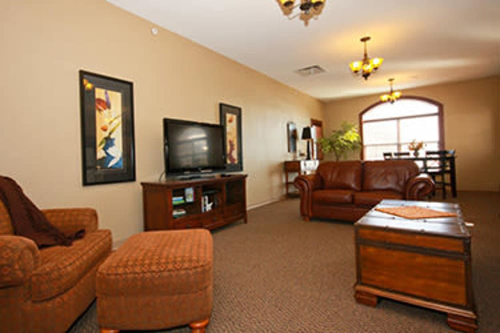 Assisted living club room with TV at Milestone Senior Living in Faribault, Minnesota.
