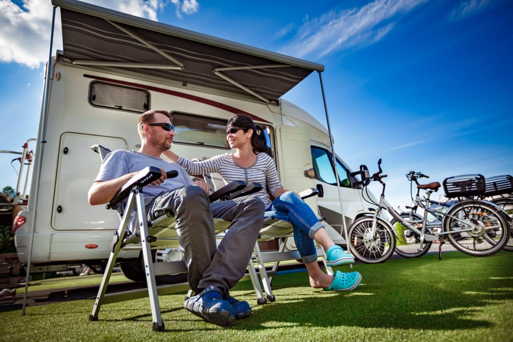 A couple in front of their RV while on a trip away from storage at B Street Self Storage in Forest Grove, Oregon