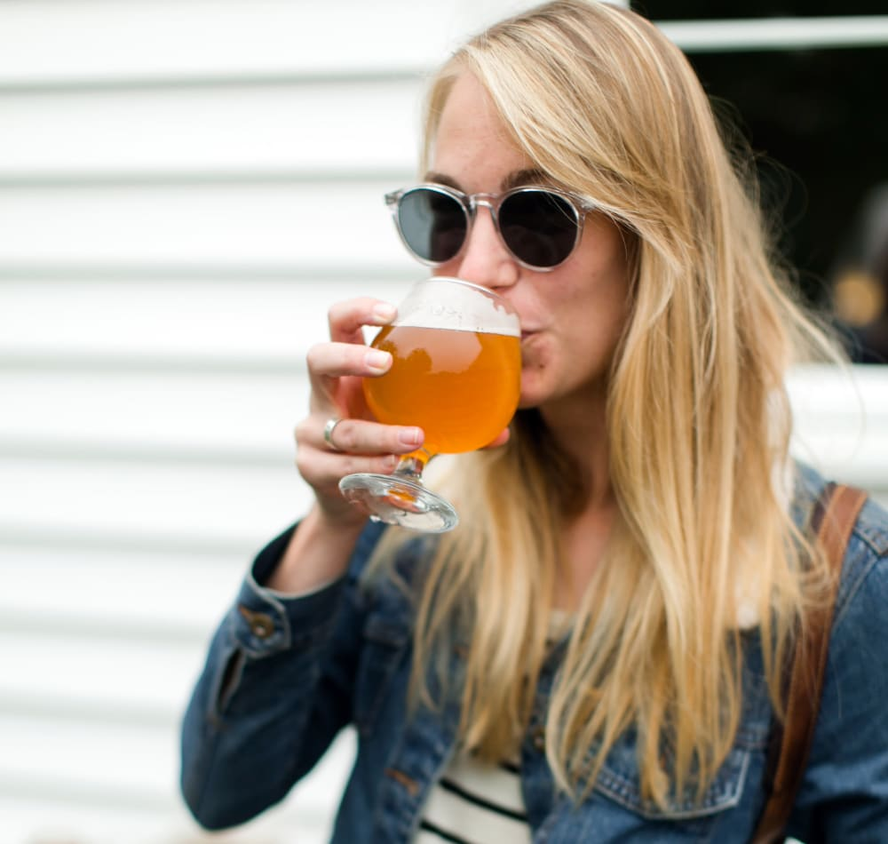 Resident enjoying a Northwest craft brew at Sofi at Forest Heights in Portland, Oregon
