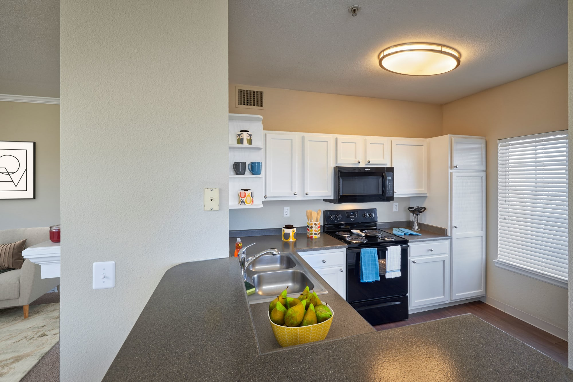 Kitchen with white cabinetry at Skyecrest Apartments in Lakewood, Colorado