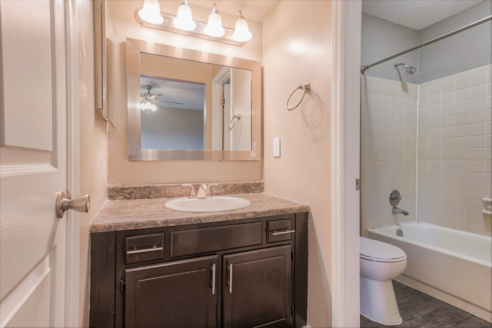 bathroom with vanity lighting at The Gatsby at Midtown in Montgomery, Alabama