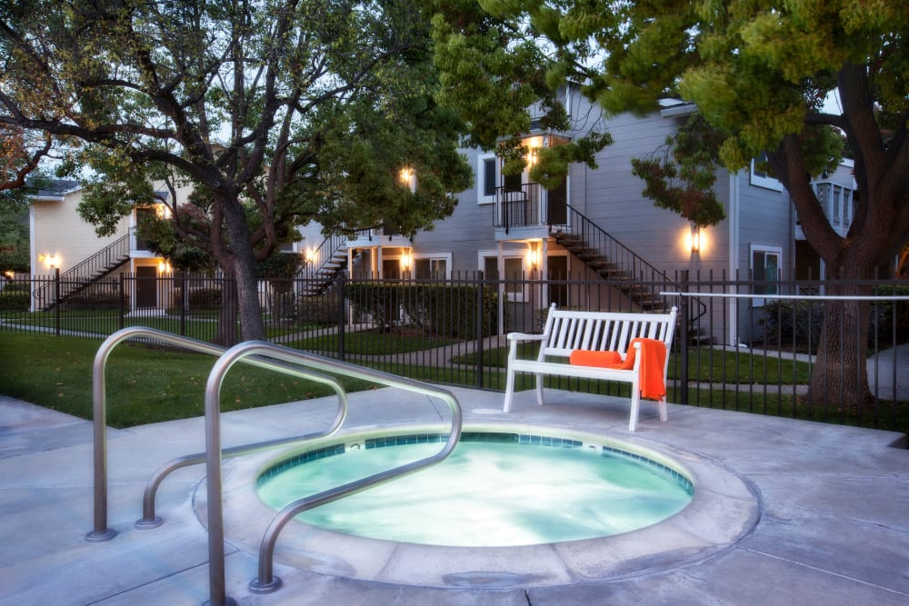 Enjoy an evening in the hot tub at Cypress Pointe Apartments in Gilroy, California