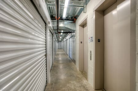 Well lit hallways at StorQuest Self Storage in West Babylon, New York