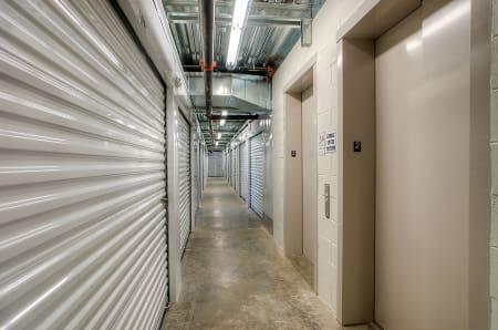 Well lit hallways at StorQuest Self Storage in North Miami Beach, Florida