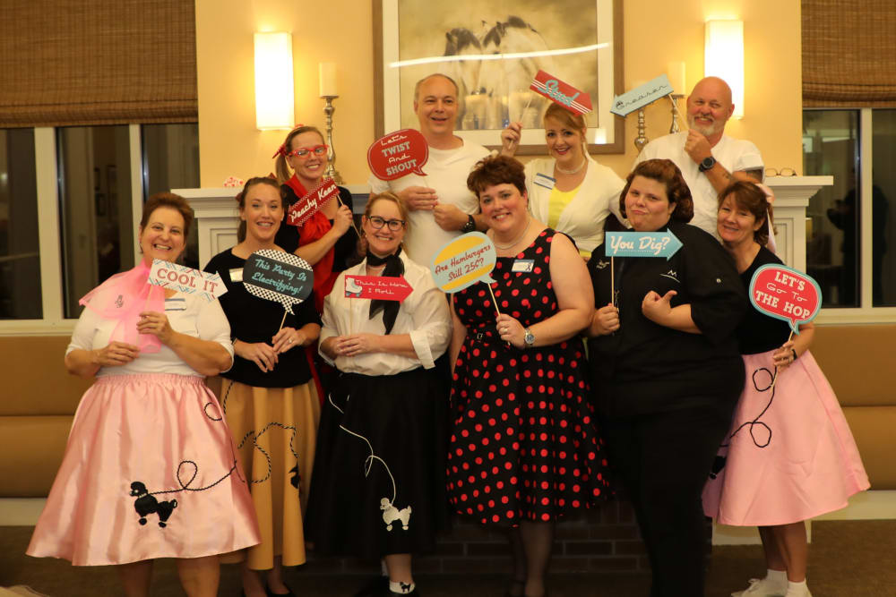 Team members at the Sock Hop Anniversary Party at Merrill Gardens at Madison in Madison, Alabama.
