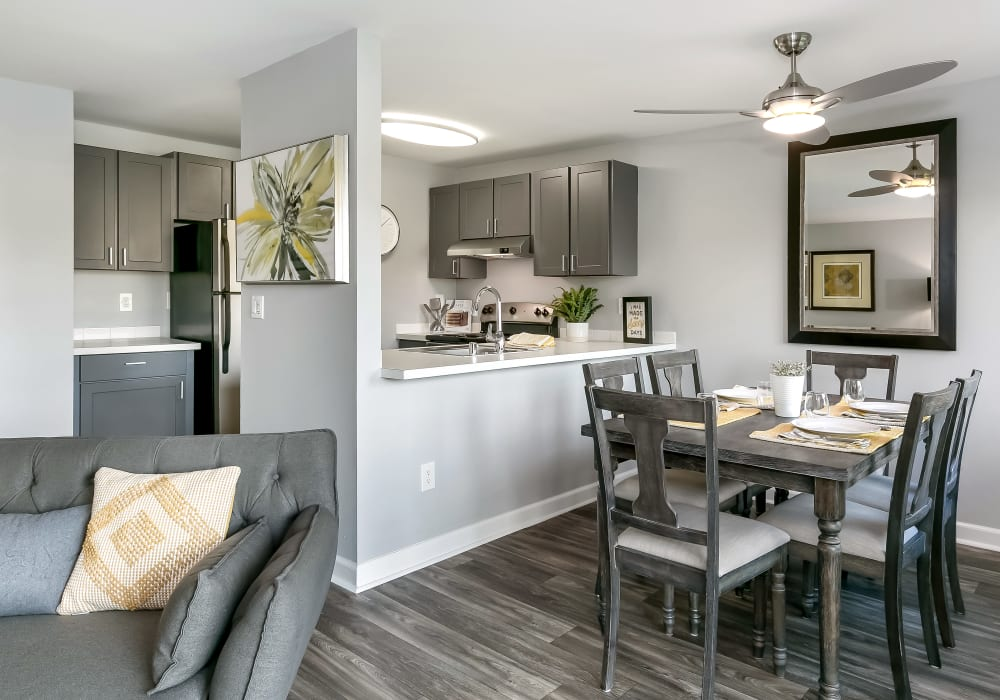 Spacious and modern open-concept layout with hardwood floors in a model home at Sofi Lakeside in Everett, Washington