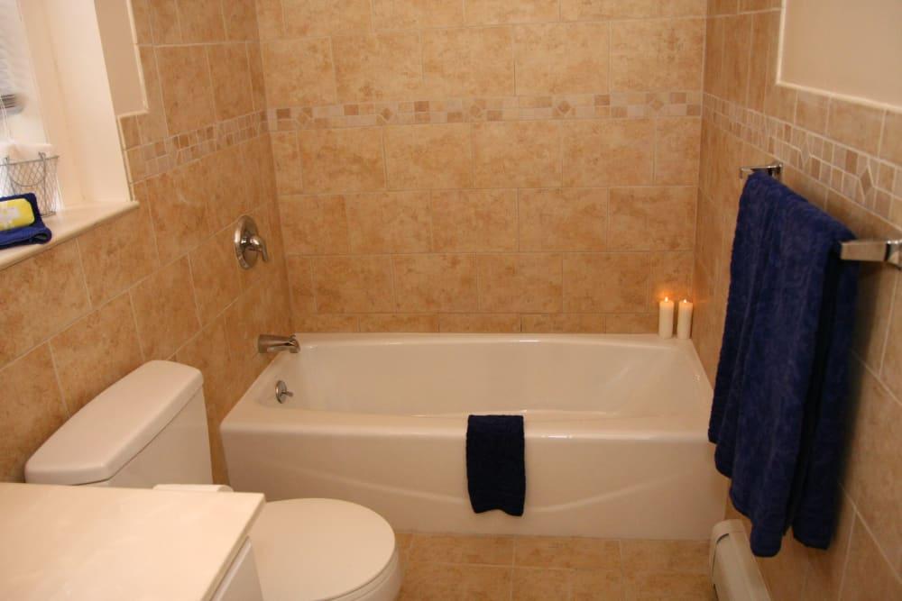 Spacious bathroom with tub at Cedar Village