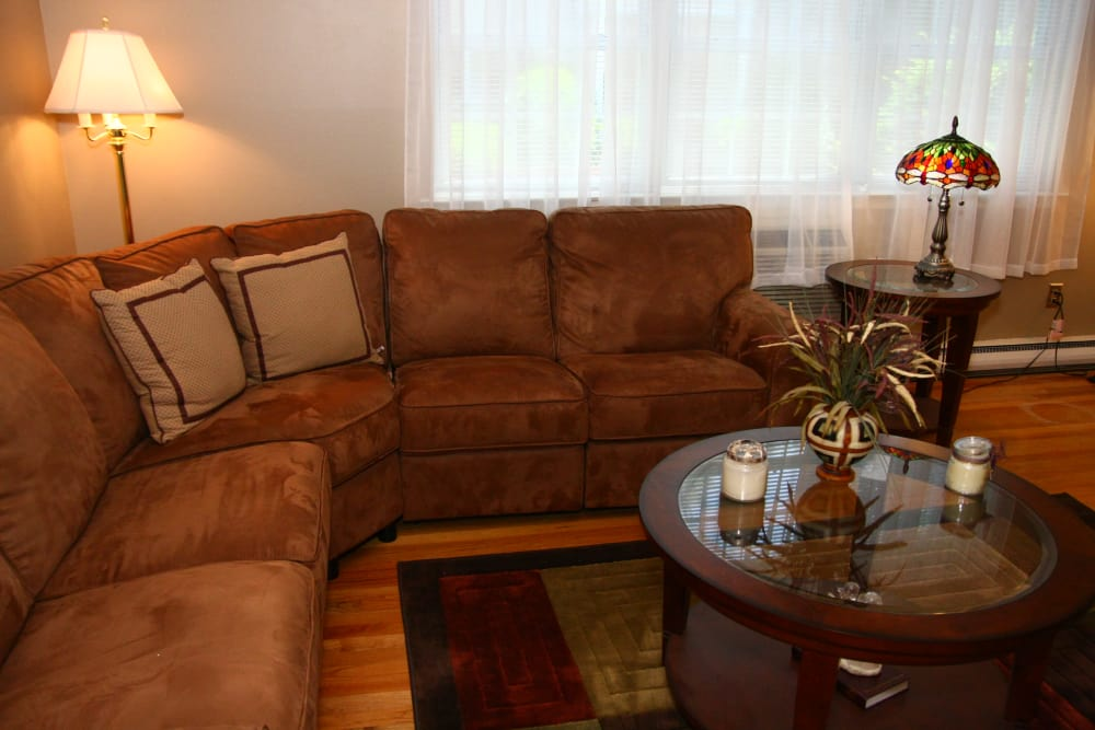 Closer view to a brown couch in spacious living room at Cloverdale Associates