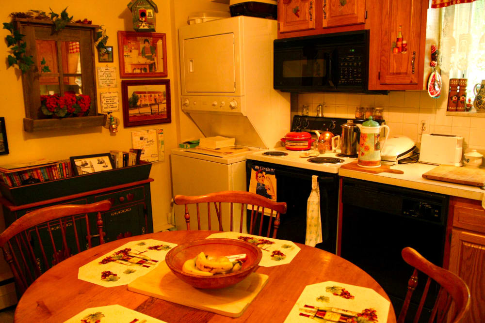 Dining room table and kitchen appliances at Haddon Knolls Apartments
