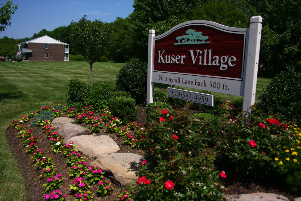Our sign and beautiful green spaces at Kuser Village