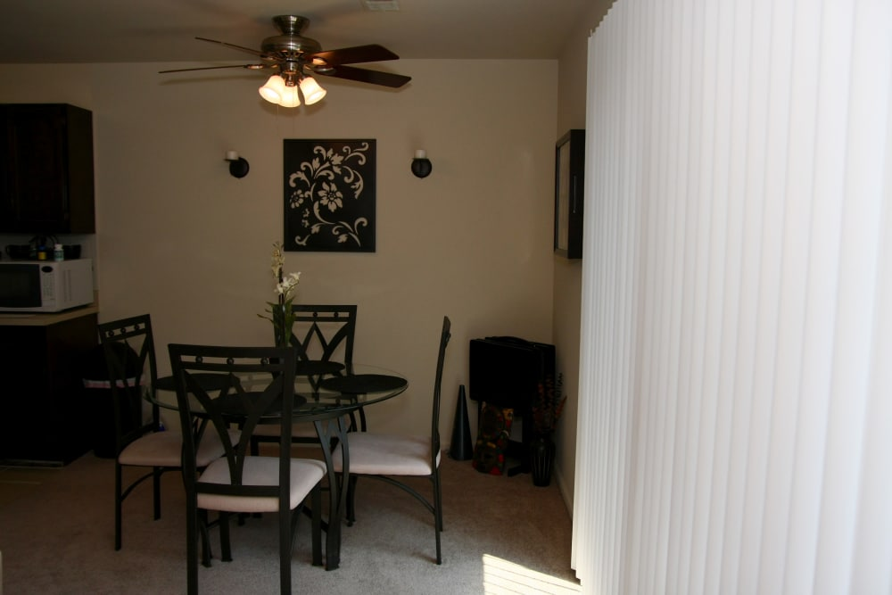 Dining room with ceiling fan at North Hills Apartments