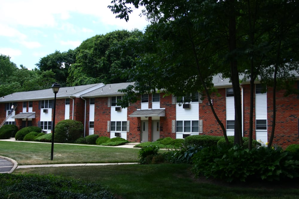 Beautifully maintained green spaces and more await you at Pointe Breeze Apartments in Bordentown