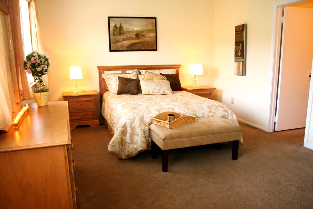 Large and well-decorated bedroom in model home at Timber Ridge