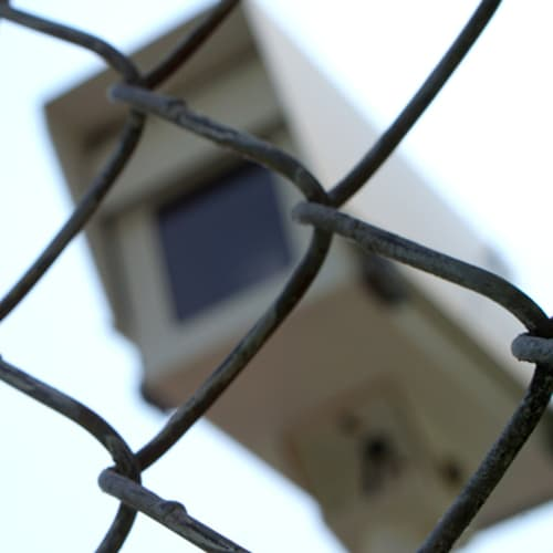 Security camera behind a fence at Red Dot Storage in Granite City, Illinois