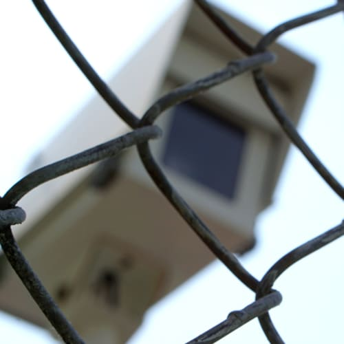 Security camera behind a fence at Red Dot Storage in Lansing, Michigan