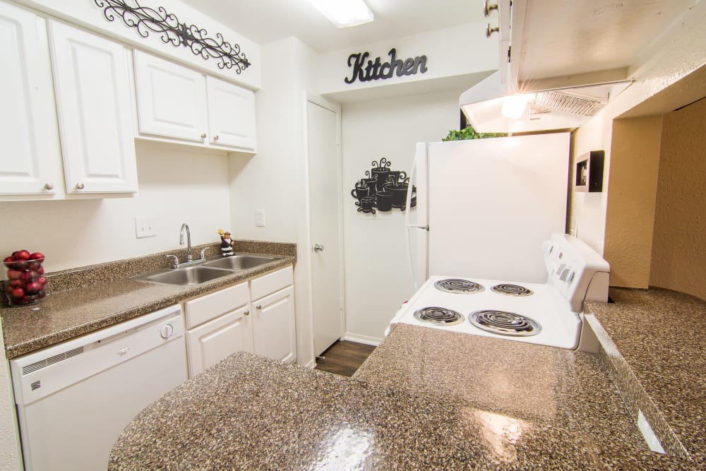 Well-lit kitchen at Meadowbrook Apartments