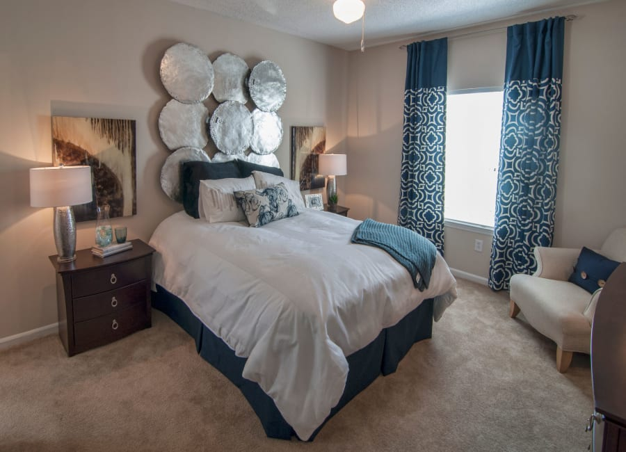 Well-decorated bedroom at Amber Chase Apartment Homes in McDonough, Georgia