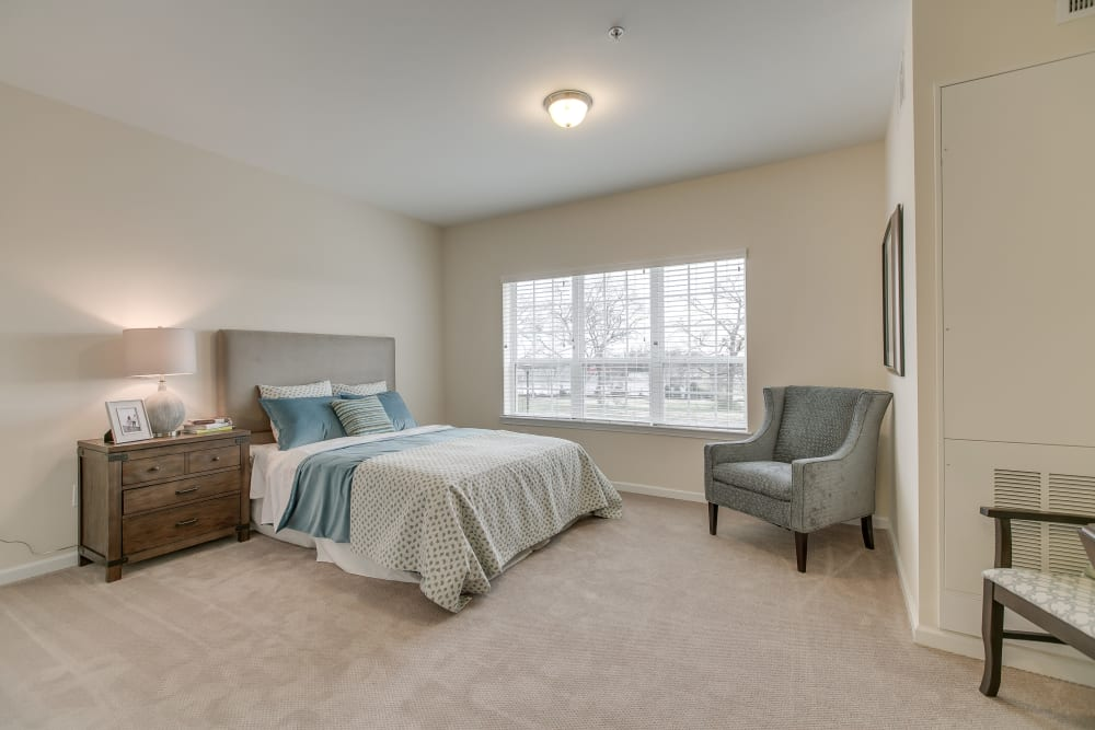 A spacious, decorated bedroom at Harmony at Victory Station in Murfreesboro, Tennessee