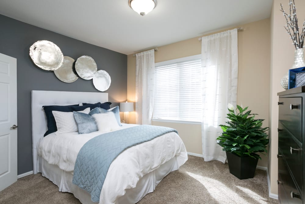 Large bedroom with a ceiling fan at Crestone Apartments in Aurora, Colorado