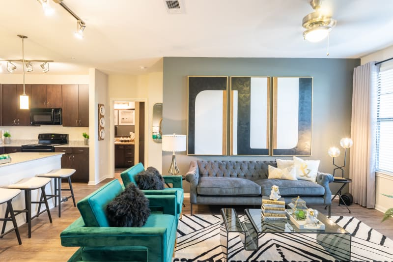 Well-furnished model home's living area at Haven at Liberty Hills in Houston, Texas