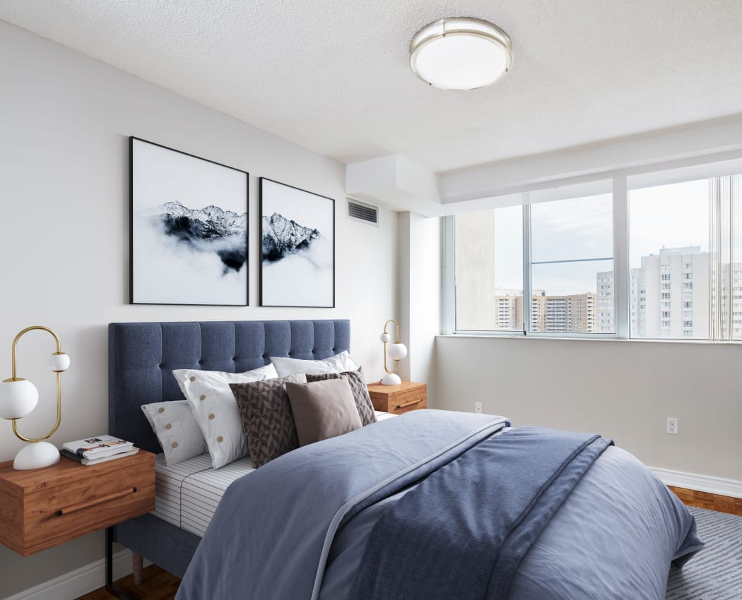 Model bedroom with city views at Mississauga Place in Mississauga, Ontario