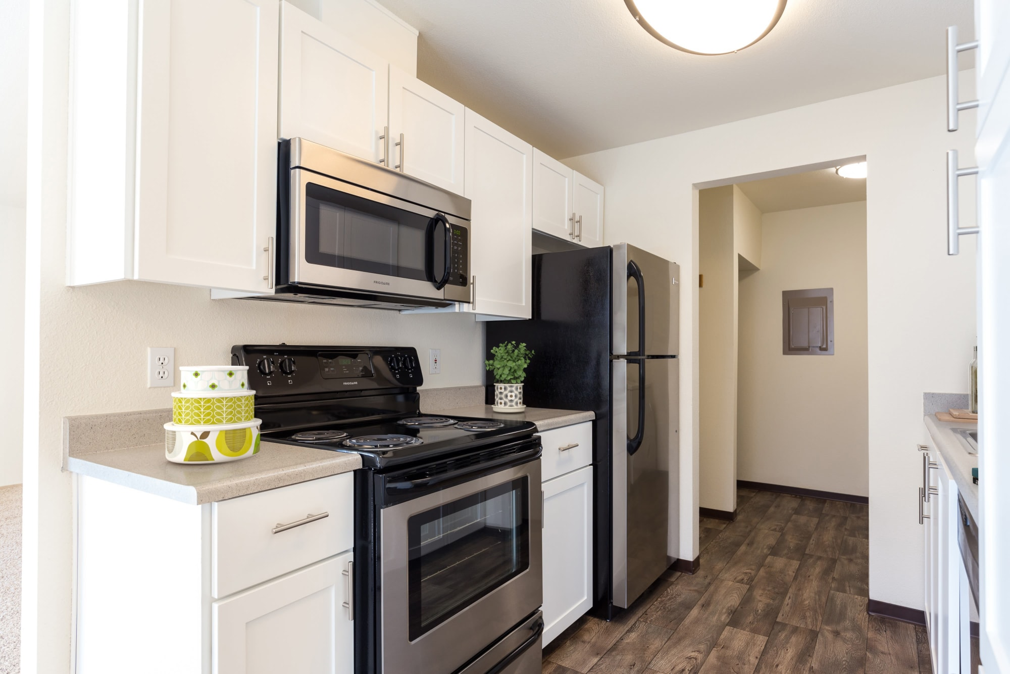 White renovated kitchen at Renaissance at 29th Apartments in Vancouver, Washington