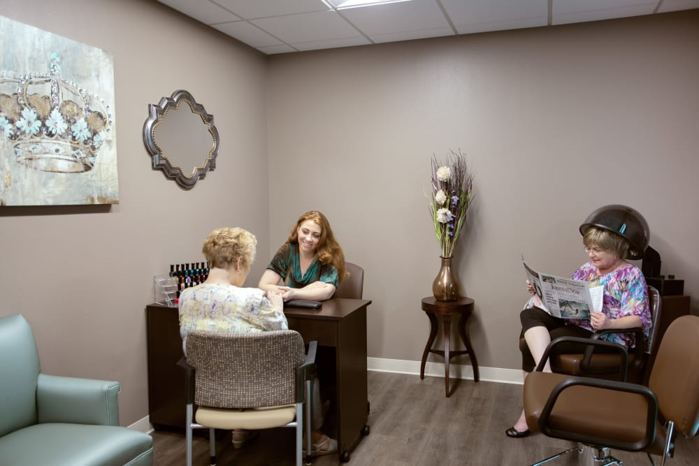 Resident setting up an appointment in the hair salon at Serenity in East Peoria, Illinois